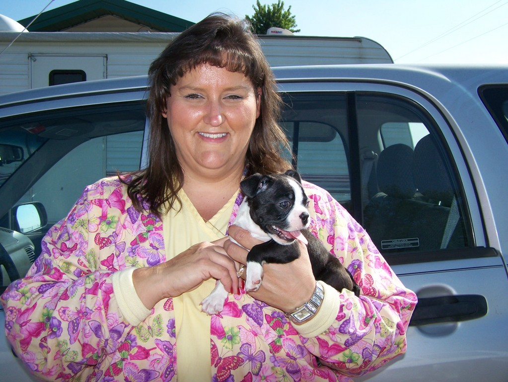 Spencer and his breeder at 6 weeks